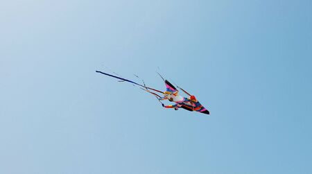 playthings: One colorful foam plane toy on the light blue sky
