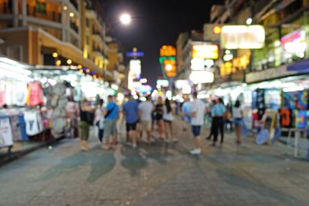 wanderers: Travelers stands at night market in blur mode