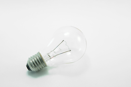 objectivity: A unplugged light bulb with white background