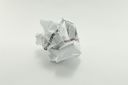 wastrel: wrinkled crumpled marketing report paper ball in dark tone Stock Photo