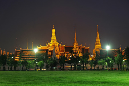 Wat Phra Kaew with Sanam Luang at night Stock Photo
