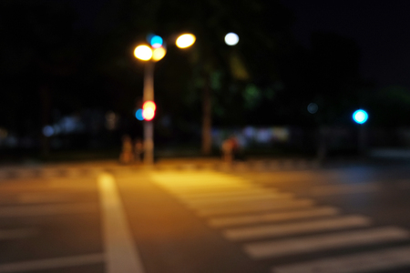 circumspect: Light signal with mast at Roadside with crosswalk in the night in mode blur Stock Photo