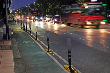 pointless: street corridor with the road and several vehicles at night in blur mode Stock Photo