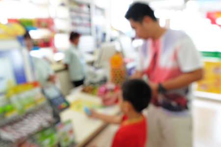 checkout counter: Father and son wait calculating at Checkout Counter in grocery stores in blur mode
