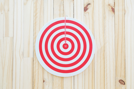 dartboard: Dartboard is shown one to ten points on wood wall Stock Photo