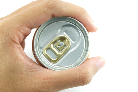 potation: the top side of a aluminium pull tab selected focus of can which is held by hand with white background Stock Photo