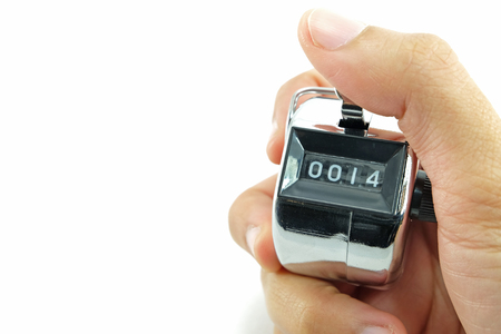 betray: number 0014 selected focus shown in number counter held by hand with white background Stock Photo
