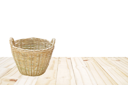 enrich: the brown weave basket on wood ground with white background