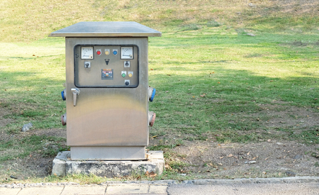 distribution board: Main distribution board in the public park with lawn garden Stock Photo