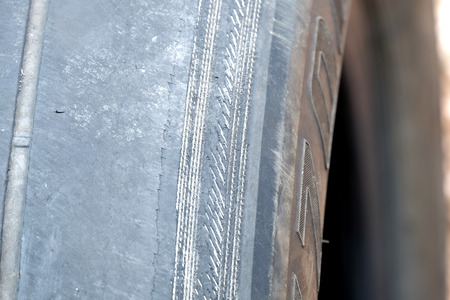 mileage: wire in a deteriorate tire (center of frame is selected focus)