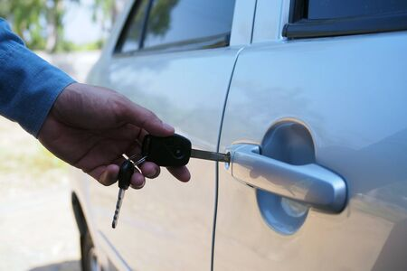 The car owner uses the key to open the car door.