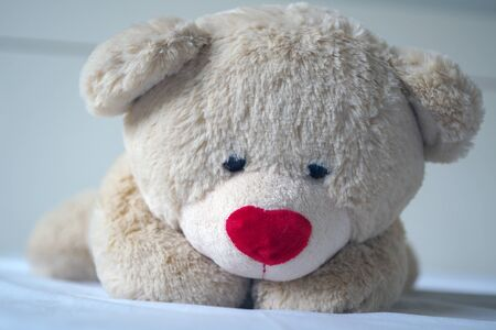 Depression concept Grief of children. The teddy bear sleeps sadly in the bed. It seems that people who are sad, disappointed.