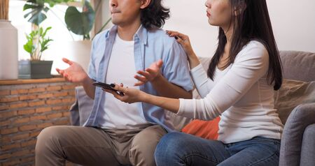 The wife needed an explanation of the untrustworthy story on her husband's personal phone sitting on the living room sofa in the house.