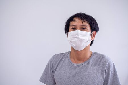 Face image of Asian men wearing masks to protect against Corona Virus or Covid 19 and toxic fumes and dust. PM 2.5