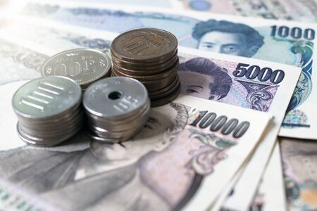 Japanese yen notes and Japanese yen coins for money concept background. 版權商用圖片