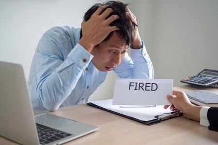 Business men are shocked and stressed The executive sent a letter to dismiss from the job. Business bankruptcy Foto de archivo