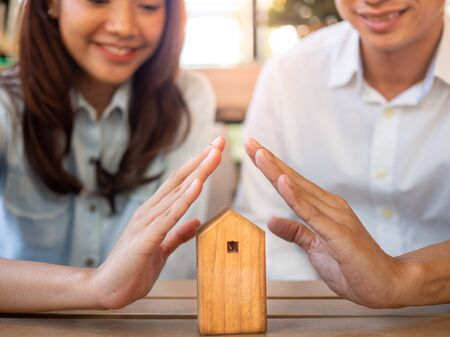 The beginning of the family life of happy couples in a new home. Insurance for property protection is home and health.