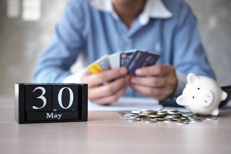 Businessmen are stressed with the end of the month having to pay for credit cards.