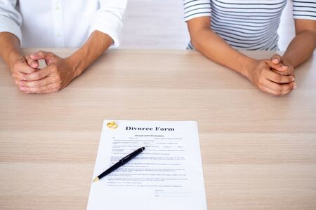 Lovers with a divorce contract and a ring on the table Divorce, filing divorce documents or prenuptial agreements made by lawyers