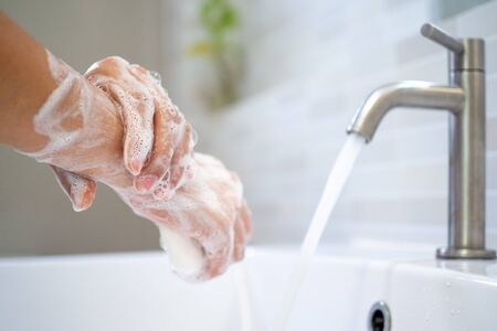 Washing hands with soap and water. Women scrub hand soap with wash basin .The concept of hand hygiene and hand washing days around the world. reduce the accumulation of bacteria and viruses.