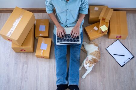 The seller is selling online, uploading images and promote products via an internet connection using a computer. The products pack in the box for delivery to customers order through the website.