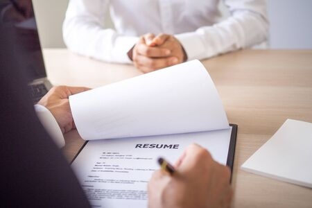 Executives are interviewing new employees, based on resumes, work experience and Attitude about working in the company.