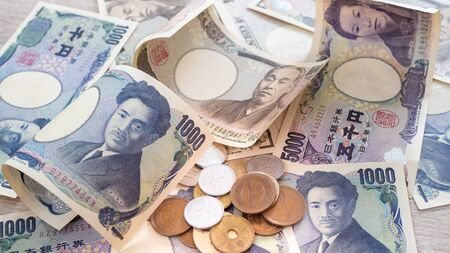 Japanese banknotes and coins close up