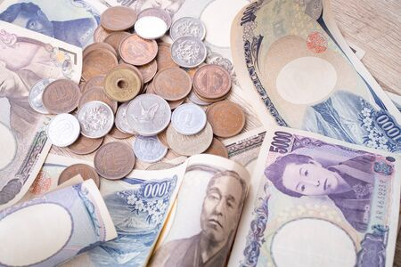 Japanese currency banknote and coins close up