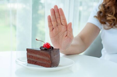 The women used to push the cake plate with the people. Do not eat desserts for weight loss.