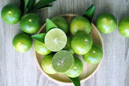 Lime placed on a wooden plate