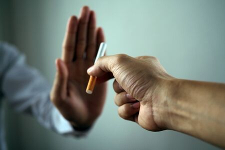 The hand rejected the cigarette that was handed over. Smoking Concepts Causes of Lung Cancer. Just say no 스톡 콘텐츠