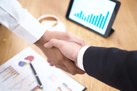 Completed a happy business deal. Both businessmen agreed to be partners that work together as a team.