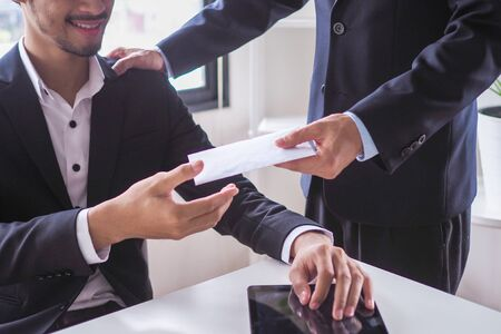 Managers are accepting bonus envelopes from the CEO after the company's annual results are summarized.