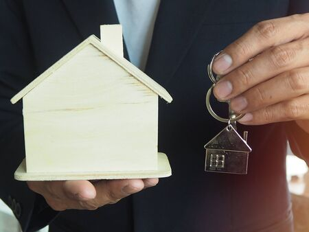 Homeowners are delivering home keys to tenants or buyers. Home sales concept