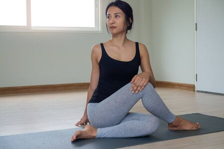 Women are doing seated twist exercises for health and a firmer body. yoga concept