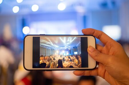A photo of a woman's hand taken at the wedding ceremony with a mobile phone.