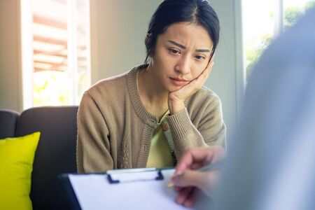 The girl consulted with a doctor or psychologist complaining about health problems with both physical and mental problems. Focus on mental symptoms, sadness.