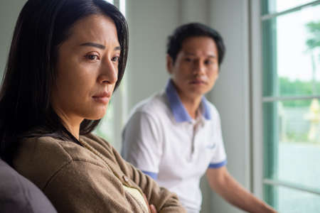 The wife is feeling dissatisfied and angry the husband. The Asian couple is having relationship problems, conflicts, quarrels, causing divorce. Conceptual love problem and divorce