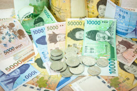 Korean currency , Many Korean bank notes and coins Placed on the table.