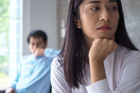 An Asian woman is stressed and anxious about the love problems between her husband after an intense quarrel. Concepts of lovers having family problems, divorce or quarrels or conflicts