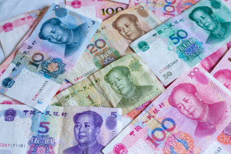 Chinese money , Many Chinese bank notes Placed on the table.