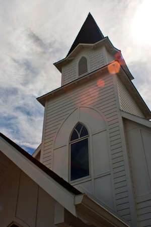 The steeple of the little white church
