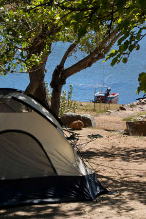 camping site: a tent camping site with boat on the lake