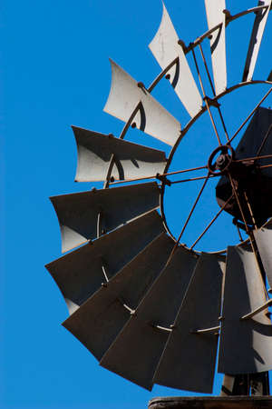 head close up: vertical windmill head close up with some blue sky Stock Photo