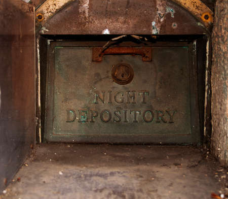 depository: vintage night depository box, abandoned, burried in a wall, rusty, dirty,  Stock Photo