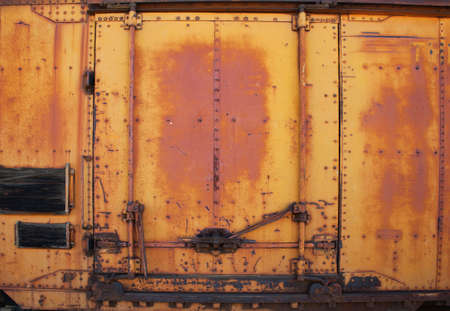 vintage metal train car door. Side view of car rusty with the door closed. photo
