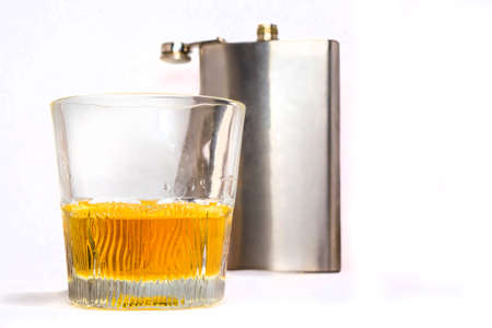 flask and glass tumbler isolated on a white background