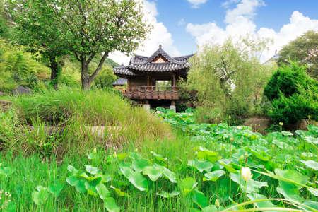 Asian summerhouse on a pond Stock Photo
