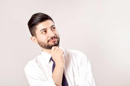 Portrait of businessman on gray background.