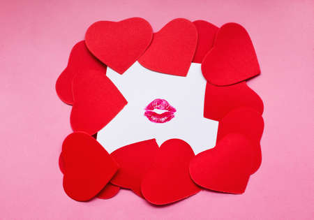 Heart shape cards on kissed white paper. Valentine day concept.